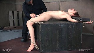 Cute redhead is his submissive slut taking abuse in the dungeon