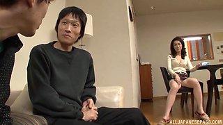 Japanese brunette housewife Shizuka Akiyama strips and sucks cock