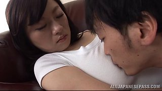 A busty Asian girl has her shirt pulled off and her nipples sucked