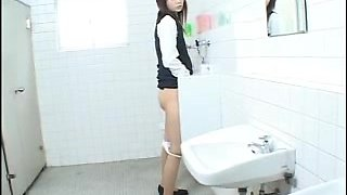 Tall Japanese babe in a men.s toilet