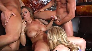 sexy blondes are fucked by big cocks in a foursome