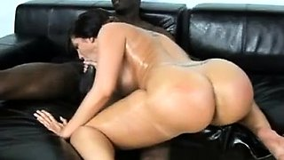 Curvaceous brunette takes a big black cock for a wild ride