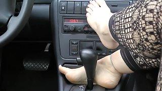 Gorgeous feet in the car