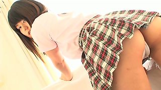 Lovely Asian Yusa Ozawa takes off her college uniform to show what she's got