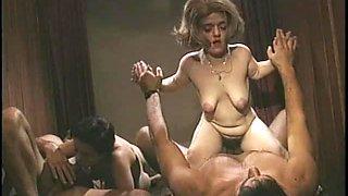 Midget sex in a group scene