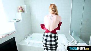My redhead busty MILF stepmom blows me in the bath