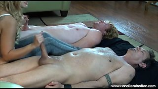 dominant mistress controls 2 big cocks during femdom handjob