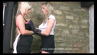 Busty blondes put on sexy leather gloves to caress big tits