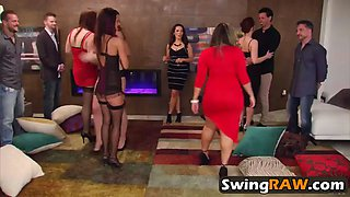 swinger couples swapping partners during a reality show