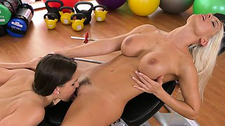 Two busty lesbians training at gym