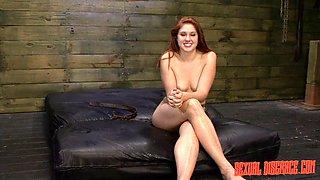 Redhead slut gets abused hard on her bondage session