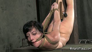 Horny bitch is punished and suspended in the dark room