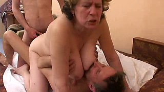 Vivacious granny fucks her two younger neighbors in a steamy threesome