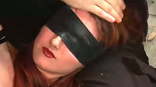 Blind folded porn is punished on the cold floor