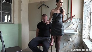 Mistress in a tight leather dress Ashley Ocean spanks her tied up man