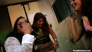 Horny girls are going naughty in a club eating one another