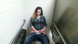 Big titted chick masturbates in public toilet