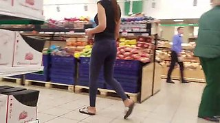 beautiful girl with a sporty ass in the supermarket