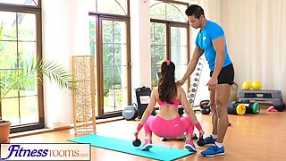 FitnessRooms Gym instructor pulls down her yoga pants