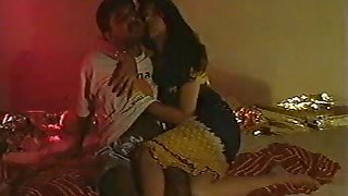 married indian couple in bedroom seducing each other