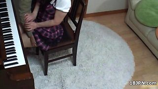 Cute Asian teen babe gets groped by her piano teacher