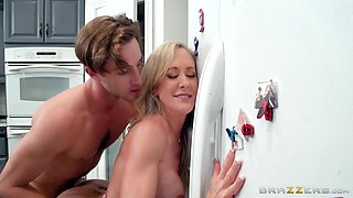 Before dinner, Brandi Love gets a nice sausage in the kitchen