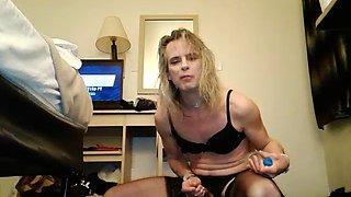 crossdresser rides a bottle and swallows cum