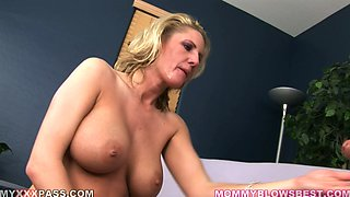 Blond cougar with huge tits is going to give a nice head