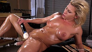 Oily blonde MILF gets hammered by a fuck machine