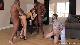 Cruel wife Riley Reid is fucked by two black dudes under her husband's nose
