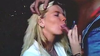 Sexy blonde milf giving her man head in the public park and swallowing his cum