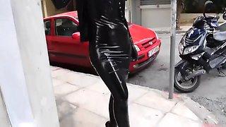 Black latex dress and very high heels