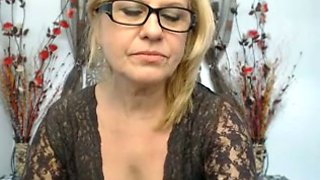 Blond haired cam nympho in black stuff and glasses exposes her tits