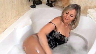 mature teasing in bath tub