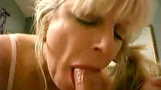 Mature blonde vixen insatiably sucking my pink shaft