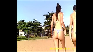 two young skinny girls in thong bikini on the beach!