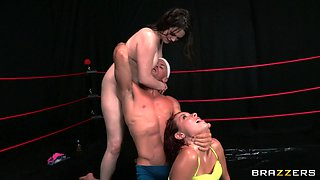 Threesome in the wrestling ring with two big titty babes