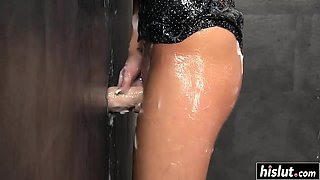 Brunette gets showered in glory hole jizz
