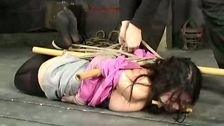 Tied up and punished Asian porn model Koan